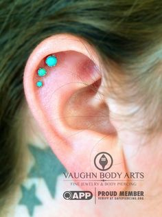 We are in love with how gorgeous Lauren's triple helix looks, shown here at two weeks old. These graduating sized turquoise ends from anatometal were the perfect choice for her ear. Thank you so much Lauren!