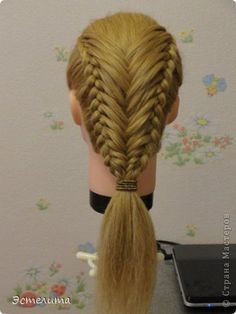 featherd dutch braids on sides and feathers are french fishtailed togeter