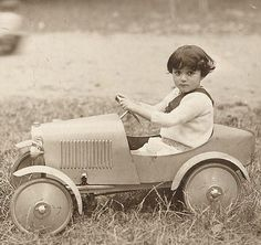 Boy in a toy car ... Want to insure your sweet toy's come to the Agents that can cover them properly. Car insurance and classic auto Insurance from House of Insurance in Eugene, Oregon