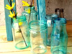 Create your own colored glass jars that look like sea glass.  You will need:   Clean jar, Mode Podge or White Elmers' glue, Paint Brush, Food coloring, Patience