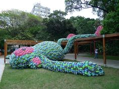 The sculpture Fat Monkey was designed by the Dutch artist Florentjin Hofman and is in Sao Paulo. It is made of  thousands of colorful chinelas (flip flops).