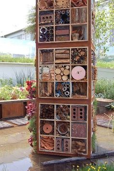 Insect 'hotels' - see the designers of the Future Nature garden talk about this part of their design at http://www.bbc.co.uk/chelsea/show_gardens/future.shtml