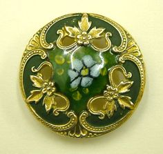 One x 25mm Antique Green and Gold Champlevé Pierced Enamel Button.