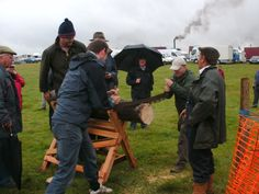 Volunteers attempting to cut the wood at the Masham Steam Rally which was held over a weekend in July in 2011.