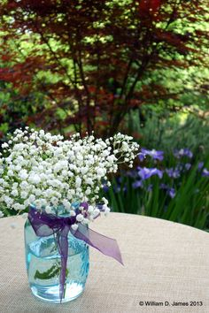 blue mason jars with purple flowers and baby's breath - Google Search