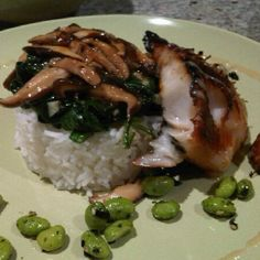 Miso glazed Black Cod with spinach, shitake mushrooms and edamame.  Super easy to prepare miso glazed cod, melts like butter and is absolutely delicious!  Make it at home for a fraction of the price in a restaurant!