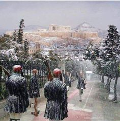 NEITHER RAIN NOR SNOW NOR GLOOM OF NIGHT CAN STAY THE EVZONES ABOUT THEIR DUTY - Athens, Changing of the Guard. #Greece