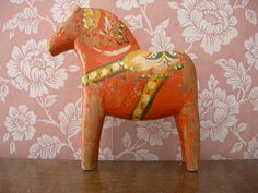 """""""battered dala horse""""... I would say well loved.. Just think of all the adventures!"""