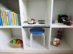 Book shelf doubles as a play kitchen