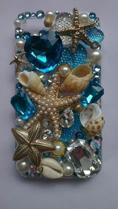 I love this pretty beach-inspired decodenned iPhone case. The rhinestones are nice, but I think pearls would've worked just as well. Maybe even better.