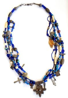 Handmade Ethnic Necklace. Blue glass African trade beads with Metal and Bone Charms. Very special.. $125.00, via Etsy.