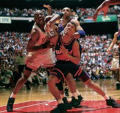 Michael Jordan boxing out Kevin Johnson and Charles Barkley during the 1993 NBA Finals