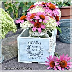 Paint an old wooden box, maybe apply something with modpodge, and put flowers inside. Either plant them or just use a small vase.