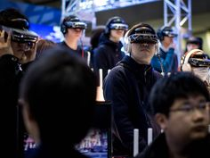 People watch a concert on virtual reality headsets during the Anime Japan 2015 Expo in Tokyo.  Chris McGrath, Getty Images
