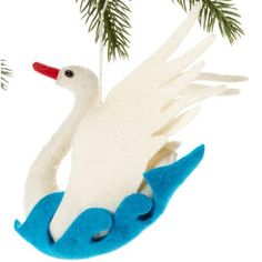 Swan Felt Holiday Ornament - Silk Road Bazaar (O) Women in Kyrgyzstan made this ornament by hand from felt. With a loop for hanging, the ornament is 5 inches tall.