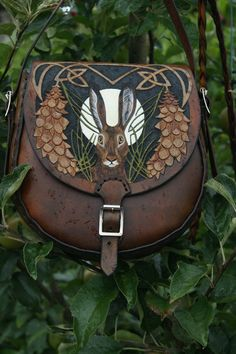Beautifully detailed small bag with hare and white pine design scattered with bees
