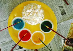paint popcorn with edible paint - sweet evaportated milk and food coloring. Also check out their drive-in movie theater idea/popcorn week... cute!