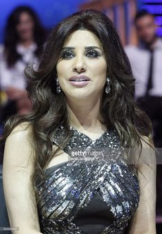 Lebanese singer Najwa Karam, one of the judges, watches the acts during the…