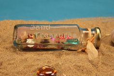 Sand Treasures Bottle. Kids love collecting little treasures they find in the sand at the beach. Tiny shells,  interesting rocks, tumbled bits of glass, it's better than pirate's booty! Children really go wild over making this craft project. They literally can bottle a bit of the beach they brought home from vacation.   http://www.etchtalk.com/Item/sand-treasures-bottle