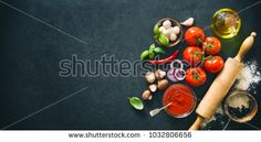 Stock Photo: Delicious pizza with ingredients and spices. Top view with copy space on wooden table