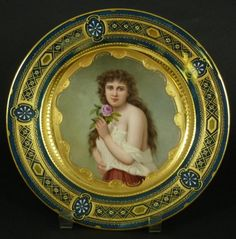 ROYAL VIENNA AUSTRIAN PORCELAIN PORTRAIT PLATE. HAND PAINTED, DEPICTING A GIRL WITH FLOWERS