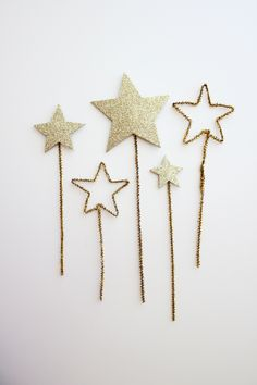 Gold star cake toppers. You could also use these in a centerpiece or mixed in with a festive holiday bouquet