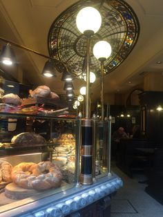 A bakery that offers sitting area. All kind of bread are stuffed in front of the display window to allows customers a clear glance of they do they sell.
