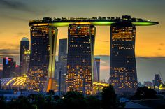 The 340-metre long Skypark sitting 60 stories high on three Marina Bay Sands Singapore hotel towers looking like cricket stumps. The rooftop strip is regarded as one of the world's Largest cantilevers.