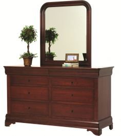 This Louis Phillipe Low Dresser is full of the spirit of the Queen Anne Style.  It has grace...beauty...and it is sophisticated.  This solid wood dresser is truly a piece of art in any bedroom.