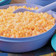 Cheesy Creamed Corn made with frozen corn, cream cheese, butter, and american cheese slices.