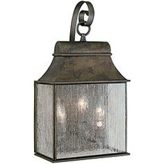 @Overstock - This Revere Outdoor lantern consists of a durable steel construction with a simple design that blends nicely with any home exterior. Protective Flemish finish is complimented by the water seedy glass panels that reflect light from the candelabra bulbs.http://www.overstock.com/Home-Garden/World-Imports-Revere-Collection-Outdoor-3-Light-Wall-Lantern/6270422/product.html?CID=214117 $196.20