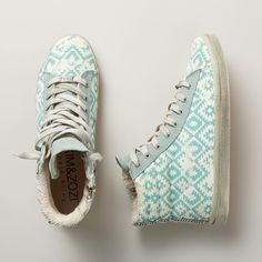 "GYPSTER HI TOPS -- Distressed and faded ethnic print adds soul to your step in these funky, hi-top sneakers. Suede trim. Terry lining. Cotton. Imported. Whole sizes 5 to 10. 1-1/4"" hidden wedge. These are running a 1/2 size large."