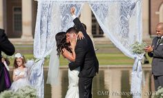 Our first kiss!❤ Beautiful backdrop for a ceremony at the Reflecting Pool in Spa Park, Saratoga Springs, NY