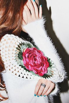 Image from http://image.dear-lover.com/productpic/Women-Fashion-Shoulder-Hollow-Rose-White-Crochet-Sweater-LC27535-1-17879.jpg.