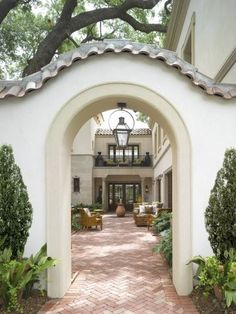 Mediterranean Courtyard = with White Arched Entryway ... FROM: SABON HOME