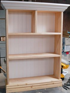 After the base molding is attached, it will extend beyond bottom edge of the unfinished shelf.