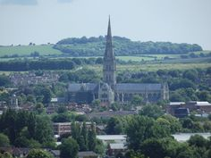 As a response to deteriorating relations between the clergy and the military at Old Sarum, the decision was taken to resite the cathedral and the bishopric was moved to its present place in Salisbury. Description from flickr.com. I searched for this on bing.com/images