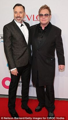 """Make this man a saint already, OK?"". Sir Elton John, right, with his partner David Furnish, called Pope Francis ""my hero"" at an AIDS benefit for the Elton John AIDS Foundation in NYC, for the Pope's push to accept gays in the Catholic Church. Elton John called Francis 'a loving man who wants everybody included in the love of God'."