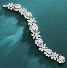 An important diamond bracelet, by Van Cleef and Arpels, circa 1950 The articulated row of six graduated marquise-cut diamonds, highlighted to each side by trios of brilliant-cut diamonds, connected by flowerhead clusters designed as marquise and pear-shap Marquise Cut Diamond, Diamond Solitaire Necklace, Pear Shaped Diamond, Diamond Bracelets, Ankle Bracelets, Sterling Silver Bracelets, Diamond Jewelry, Diamond Cuts, Jewelry Bracelets