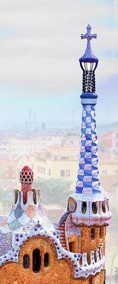 Park Guell candy House Tower by Gaudi.Detail of the rooftop and tower of one of the Entrance Pavilions of Park Guell by Antoni Gaudi, in Barcelona. Beautiful Architecture, Beautiful Buildings, Art And Architecture, Modern Buildings, Beautiful Places, Barcelona Park Guell, Barcelona Catalonia, Art Nouveau, Hotel W