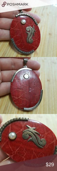 925 Silver Pendant One of a kind piece.  Beautiful red stone with a pearl & 925 silver work as well as incased with 925 silver.  Very old piece.  I bought this at an estate sale in Houston, Tx years ago.The daughter of the previous owner said her mother had it special made when she was a child to match a particular dress she owned.  I love to know the history.   I will not clean the silver unless you request I do before shipping.  Feel free to ask any questions before purchasing.   Thanks…