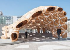 The Institute for Computational Design (ICD) and the Institute of Building Structures and Structural Design (ITKE) of the University of Stuttgart have completed a new research pavilion demonstrating robotic textile fabrication techniques for segmented timber shells.