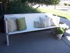 church pew in white love.  I have ALWAYS wanted an old church pew...