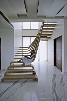 A Sculptural Staircase With Two Flights of Stairs That Connect Seamlessly