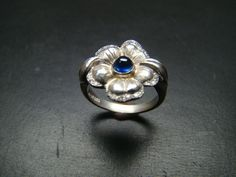 Beautiful Sterling Silver flower ring with genuine by Xidni, $280.00