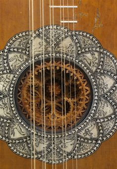 Survived Baroque guitar - extraordinarily decorated with exotic materials and a parchment rosette in its sound hole.