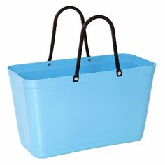 Hinza Large Light Blue Bag: The large Hinza bag is a Swedish classic designed at the beginning of the 1950's. The Hinza bag quickly became popular in Swedish homes as it was useful for a multitude of purposes, not least for carrying groceries.