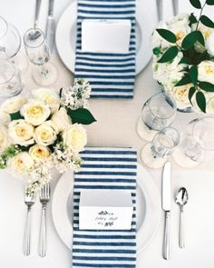 Custom-made linens, including the striped napkins, adorned tables along with all-white centerpieces arranged in vessels Brooke and Shea had collected at flea markets.