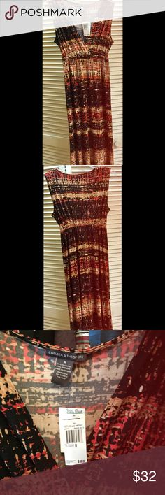 """NEW Black & Red Multicolor Maxi Dress NEW never before worn with tags Chelsea & Theodore black/red multi color maxi dress. Beautiful cool and comfortable design. Size medium. Elastic band just below breast line (see last photo) V-neck front. 95% polyester 5% spandex. Can be worn casual or add heels for a dressy look. Easy care. Machine wash and tumble dry. I'm 5'5"""" and it's the perfect length. No trades please. I offer a bundle discount. NECKLACES NOT INCLUDED. Thanks for visiting my closet…"""