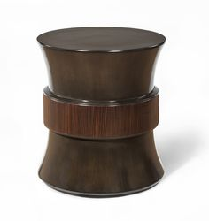 This Round Side Table from the Lily Jack Burgundy Collection features Mahogany veneer and Macassar Ebony veneer